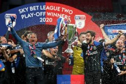 Former student lifts Play-Off Final trophy at Wembley…